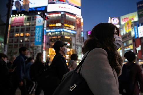People wear face masks in Tokyo's Shibuya shopping district following the outbreak of the coronavirus. Photo: Reuters