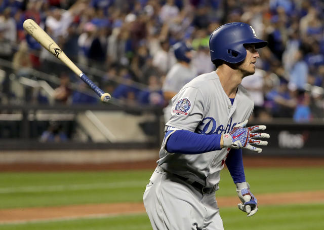 Los Angeles Dodgers' Cody Bellinger flips his bat aside as he makes his way up the first baseline after hitting a grand slam against the New York Mets during the sixth inning of a baseball game, Friday, June 22, 2018, in New York. (AP Photo/Julie Jacobson)
