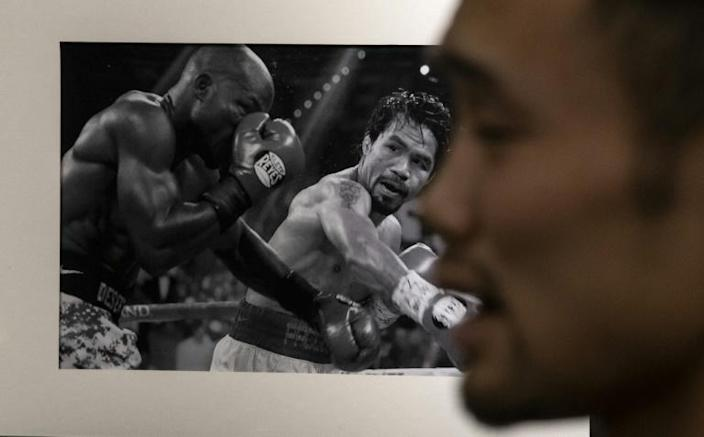 Zhang was inspired to take up boxing by the rags-to-riches rise of Philippines great Manny Pacquiao (AFP Photo/NOEL CELIS)