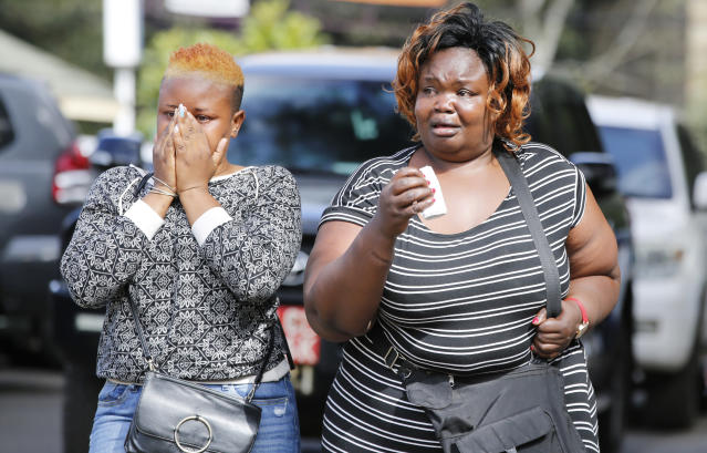 Women react after learning of a family member killed during a recent terrorist attack Wednesday, Jan. 16 2019, at the Chiromo Mortuary, Nairobi, Kenya. An upscale hotel complex in Kenya's capital came under attack on Tuesday, with a blast and heavy gunfire. The al-Shabab extremist group based in neighboring Somalia claimed responsibility and said its members were still fighting inside (AP Photo/Brian Inganga)