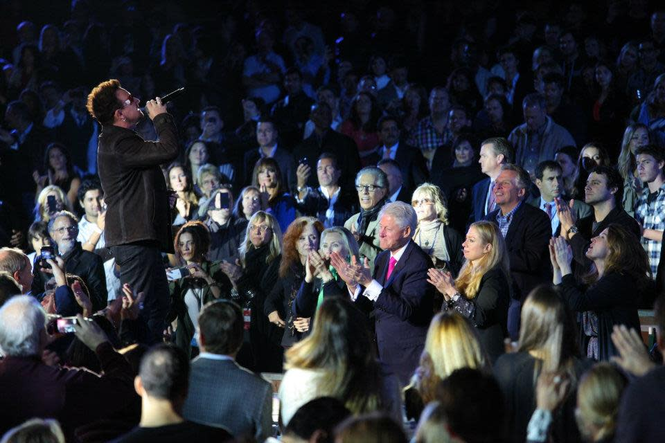 "<a target=""_blank"" href=""http://news.yahoo.com/photos/the-edge-bono-at-decade-of-difference-concert-1318792345-slideshow/"">Bono</a> sings in front of former President Clinton at ""A Decade of Difference"" concert on October 15, 2011.<br><br>(Photo by Adam Schultz / Clinton Foundation)"