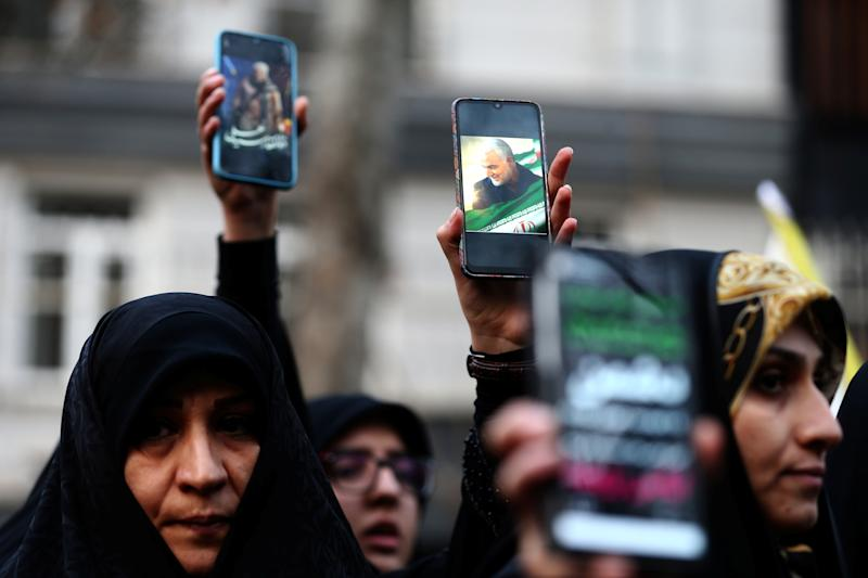 Iranian demonstrators hold up mobile phones showing the picture of the late Iranian Major-General Qassem Soleimani, during a protest against the assassination of Soleimani, head of the elite Quds Force, and Iraqi militia commander Abu Mahdi al-Muhandis, who were killed in an air strike at Baghdad airport, in front of United Nation office in Tehran, Iran January 3, 2020. Nazanin Tabatabaee/WANA (West Asia News Agency) via REUTERS ATTENTION EDITORS - THIS IMAGE HAS BEEN SUPPLIED BY A THIRD PARTY.