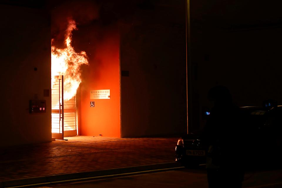 Anti-government protesters set alight the lobby of a newly built residential building that authorities planned to use as a quarantine facility, as public fears about the coronavirus outbreak intensify in Hong Kong, China January 26, 2020. REUTERS/Tyrone Siu