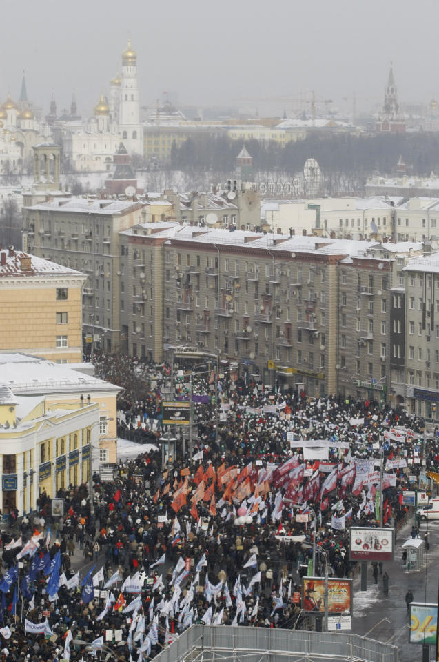 Demonstrators gather for a massive protest against Prime Minister Vladimir Putin's rule in Moscow, Saturday, Feb. 4, 2012. Thousands of Russians are taking to the streets of Moscow to demand an end to Prime Minister Vladimir Putin's rule, challenging his bid to reclaim presidency in March. The protest expected to draw tens of thousands despite temperatures plunging to minus 20 degrees Celsius (minus 4 degrees Fahrengheit). (AP Photo/Alexander Zemlianichenko, Jn)