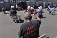 FILE - In this Sunday, July 19, 2020 file photo, church parishioners sit apart socially distanced at a prayer vigil for racial justice at Immaculate Conception Catholic Church in Seattle. The vigil follows ongoing protests over the death of George Floyd, a Black man who died in police custody in Minneapolis. (AP Photo/Elaine Thompson)