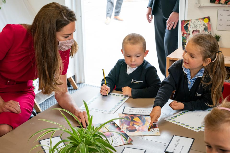 HAYLE, UNITED KINGDOM - JUNE 11: Catherine, Duchess of Cambridge talks with children in the schools Reception Class during a visit to Connor Downs Academy, during the G7 summit in Cornwall on June 11, 2021 in Hayle, west Cornwall, England. (Photo by Aaron Chown/WPA Pool/Getty Images)