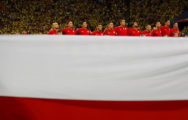 Soccer Football - World Cup - Group H - Poland vs Colombia - Kazan Arena, Kazan, Russia - June 24, 2018 Poland players lined up for the national anthem before the match REUTERS/Toru Hanai