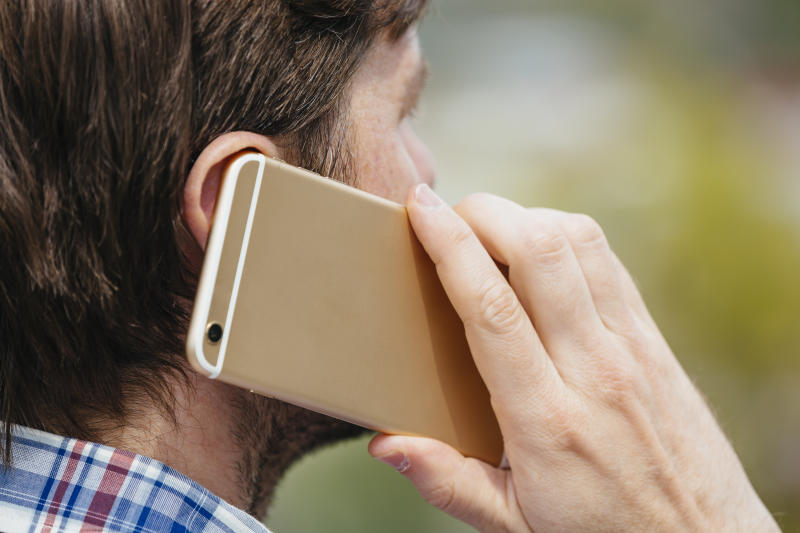 Man talking on a mobile phone, close up