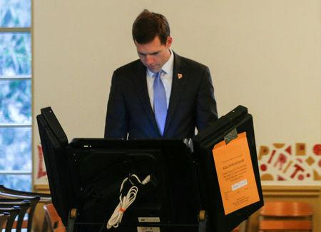 FILE PHOTO: Democratic congressional candidate Conor Lamb fills out his ballot to vote in Mt. Lebanon, Pennsylvania