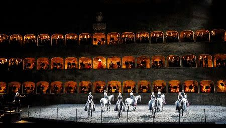 """Horses and riders perform on stage during a dress rehearsal of Wolfgang Amadeus Mozart's cantata """"Davide penitente"""" in Salzburg January 20, 2015.  REUTERS/Dominic Ebenbichler (AUSTRIA - Tags: SOCIETY ANIMALS)"""