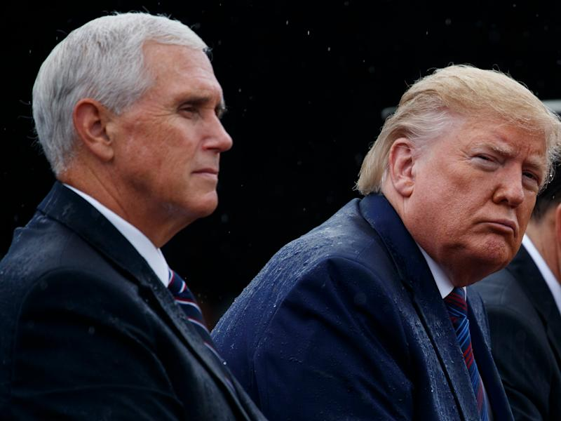 In this Sept. 30, 2019 photo, Vice President Mike Pence and President Donald Trump participate in an Armed Forces welcome ceremony for the new chairman of the Joint Chiefs of Staff, Gen. Mark Milley, at Joint Base Myer-Henderson Hall, Va. Aides to Vice President Mike Pence are disputing a whistleblower's characterization of his decision not to attend Ukrainian President Volodymyr Zelenskiy's inauguration earlier this year. And they say he never discussed President Donald Trump's potential Democratic rival Joe Biden in their repeated conversations. (AP Photo/Evan Vucci)