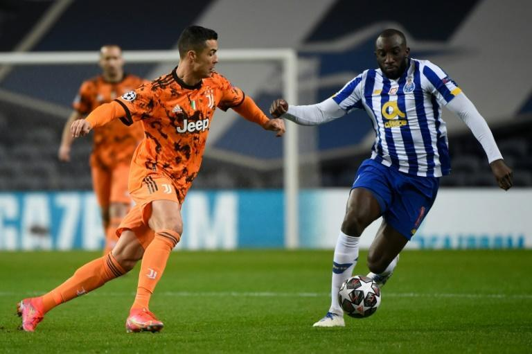 Juventus forward Cristiano Ronaldo (L) vies with FC Porto's Moussa Marega in Portugal.