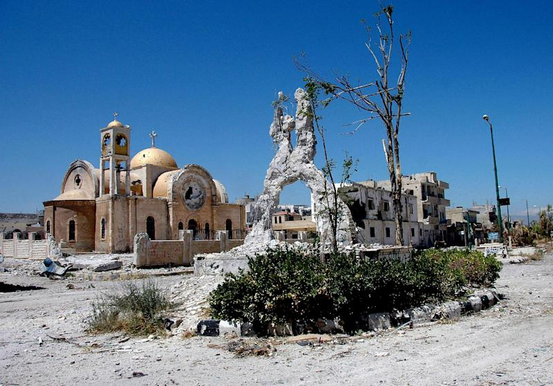 FILE - This Wednesday, June 5, 2013 file photo released by the Syrian official news agency SANA, shows a damaged church in the town of Qusair, near the Lebanese border, in Homs province, Syria. Syrian rebels' defeat in Qusair cost them more than a strategic location, it has also left a battered spirit and deep frustration. Over the course of a year, rebels holding the town had heavily fortified it with tunnels, mine fields, and booby traps and when the regime assault came they fought back ferociously. But in the end they were outgunned and outnumbered, and were forced into a harrowing, crushing flight from the town. (AP Photo/SANA, File)