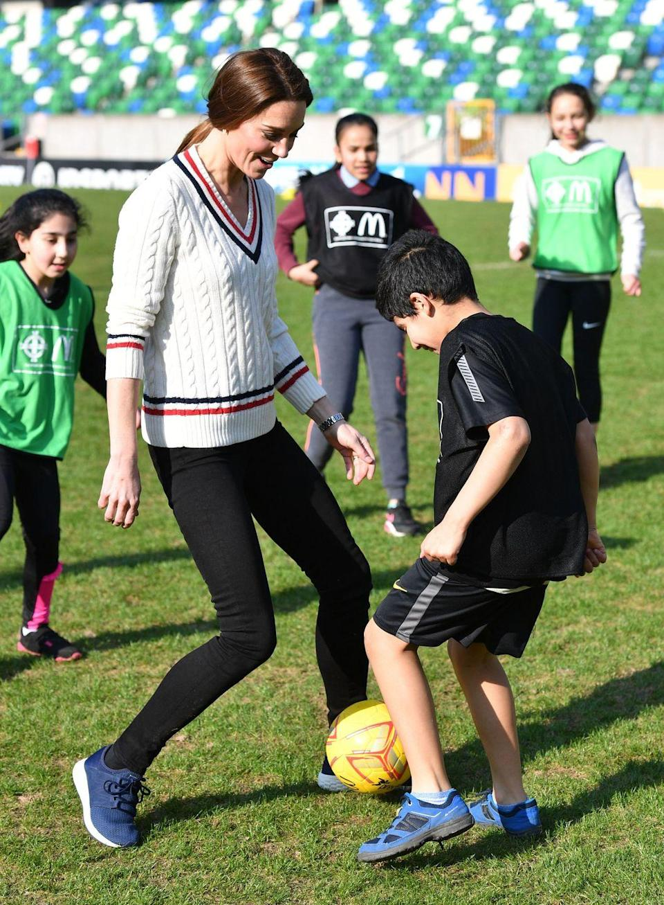 <p>The athletic Duchess played soccer (known in the UK as football) with children during a visit to the National Stadium in Belfast, Ireland, home of the Irish Football Association. </p>