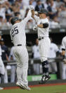 New York Yankees' Brett Gardner, right, celebrates after hitting a two-run home run with Gleyber Torres during the third inning of a baseball game against the Boston Red Sox, Saturday, June 29, 2019, in London. Major League Baseball made its European debut game today at London Stadium. (AP Photo/Tim Ireland)