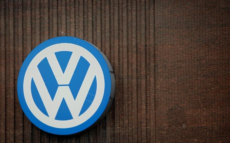 A giant logo of Volkswagen is pictured on the wall of its production facility in Wolfsburg