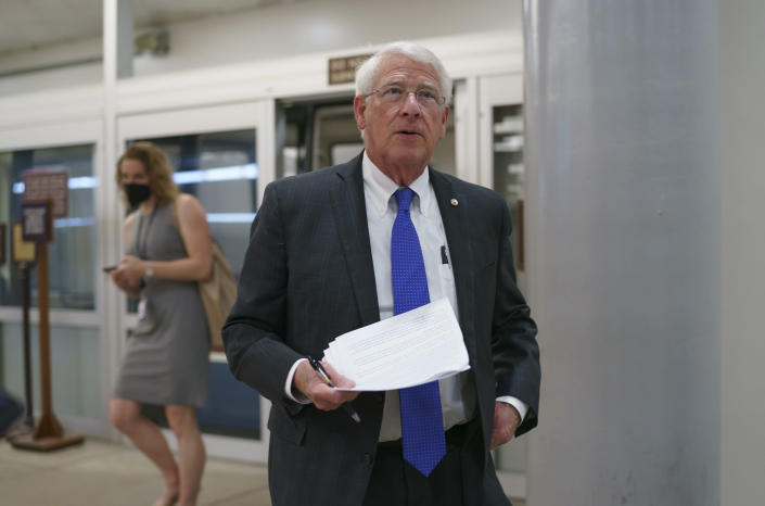 FILE - In this Thursday, May 27, 2021 file photo, Sen. Roger Wicker, R-Miss., arrives as senators go to the chamber for votes ahead of the approaching Memorial Day recess, at the Capitol in Washington. Republican Sen. Roger Wicker of Mississippi says installing massive pumps to drain water from the south Mississippi Delta would be a way to fight environmental injustice. He says the project would help low-income and minority residents whose lives are disrupted by flooding. Wicker made his statements to a Senate subcommittee Thursday, July 22, 2021. (AP Photo/J. Scott Applewhite, File)