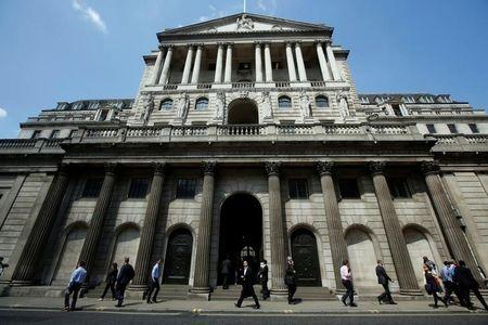 FILE PHOTO - Pedestrians walk past the Bank of England in the City of London, Britain, May 15, 2014.   REUTERS/Luke MacGregor/File Photo