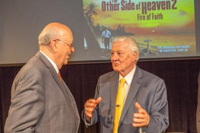 Elder John H. Groberg (right) discusses his mission experiences in the Pacific Islands in the 1950's with an attendee at a special screening held at The Fuller Seminary in Pasadena, CA. Those experiences, including overcoming tensions with other denominations, are the basis of the new film The Other Side of Heaven 2: Fire of Faith. The film opens nationwide this Friday, June 28.