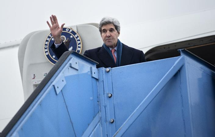 US Secretary of State John Kerry waves while boarding his plane at Franz-Josef-Strauss Airport in Munich, southern Germany, on Sunday Feb. 2, 2014. Kerry was in the Bavarian capital to attend the Munich Security Conference. (AP Photo/Brendan Smialowski,Pool)I