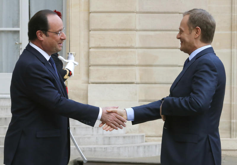 French President Francois Hollande, left, shakes hands with Polish Prime Minister Donald Tusk prior to meeting at the Elysee palace in Paris, Thursday, April 24, 2014 (AP Photo/Jacques Brinon)