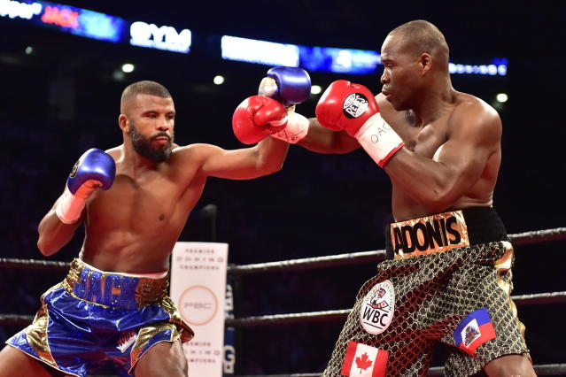Adonis Stevenson, right, and Badou Jack exchange blows during the first round of a WBC light heavyweight championship boxing match in Toronto on Saturday, May 19, 2018. (Frank Gunn/The Canadian Press via AP)