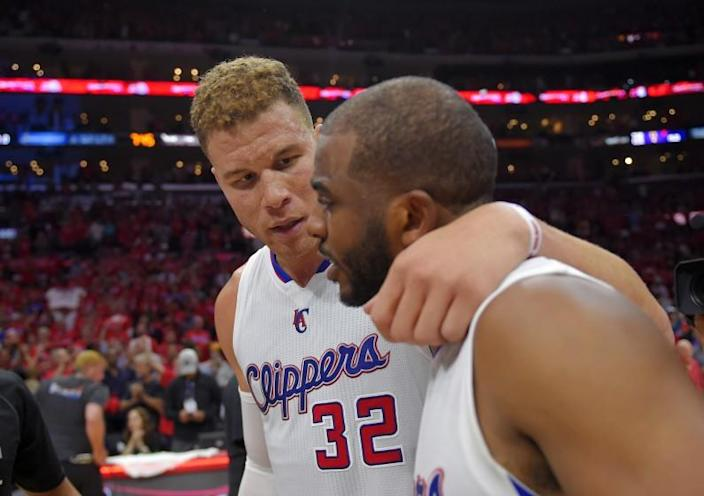Los Angeles Clippers forward Blake Griffin, left, hugs guard Chris Paul after they defeated the San Antonio Spurs.