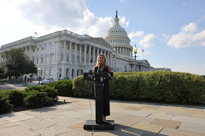 FIRE FAUCI ACT. Representative Marjorie Taylor Greene (R-GA) holds a press conference outside the U.S. Capitol following a private visit to the Holocaust Museum, to express contrition for previous remarks about Jewish people, in Washington, U.S. June 14, 2021. (Evelyn Hockstein/Reuters)