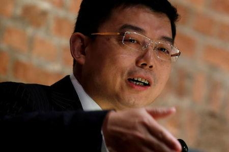 FILE PHOTO: Wang Zhenmin, the head of the law department of China's representative office in Hong Kong, speaks during a luncheon in Hong Kong, China April 12, 2016. REUTERS/Bobby Yip/File Photo
