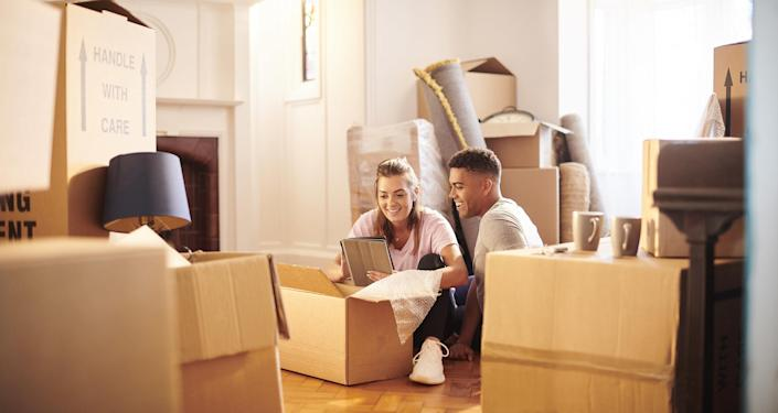 Young couple moving in to their new house