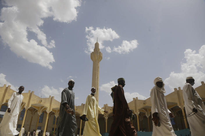 Muslims men leave after Friday prayers during the holy fasting month of Ramadan, at a Grand mosque in N'Djamena, Chad, Friday, April 30, 2021. (AP Photo/Sunday Alamba)