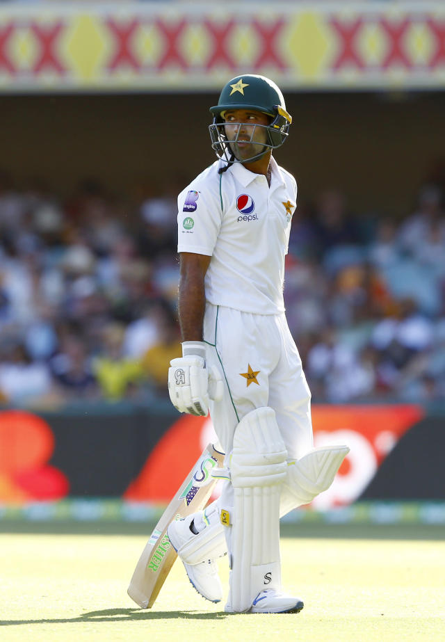 Pakistan's Asad Shafiq walks off the field after he lost his wicket during their cricket test match against Australia in Brisbane, Australia, Saturday, Nov. 23, 2019. (AP Photo/Tertius Pickard)