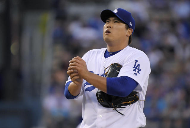 Los Angeles Dodgers starting pitcher Hyun-Jin Ryu rubs up the ball before pitching during the first inning of the team's baseball game against the San Francisco Giants on Wednesday, Aug. 15, 2018, in Los Angeles. (AP Photo/Mark J. Terrill)