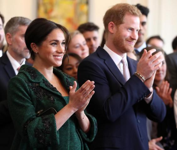 Meghan, Duchess of Sussex (L) and Britain's Prince Harry, Duke of Sussex, watch a musical performance at Canada House, the offices of the High Commision of Canada in the United Kingdom, during an event to mark Commonwealth Day, in central London, on March 11, 2019. (Getty Images)