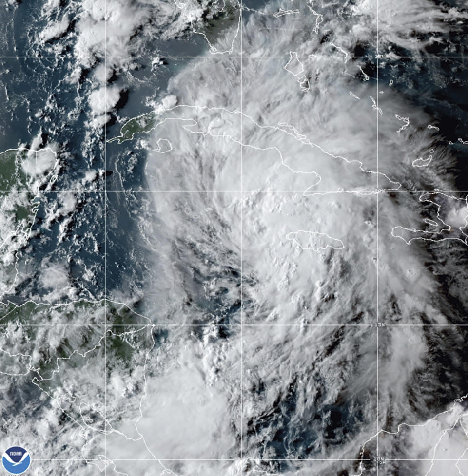 This GOES-16 East GeoColor satellite image taken Thursday, Aug. 26, 2021, at 10:20 p.m. EDT, and provided by NOAA, shows Tropical Storm Ida in the Caribbean Sea. Tropical Storm Ida formed in the Caribbean on Thursday and forecasters said its track was aimed at the U.S. Gulf Coast, prompting Louisiana's governor to declare a state of emergency and forecasters to announce a hurricane watch for New Orleans. (NOAA via AP)