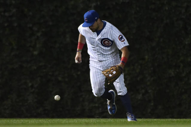 Chicago Cubs left fielder Kyle Schwarber makes a fielding error on an RBI-single hit by St. Louis Cardinals' Yadier Molina during the sixth inning of a baseball game Thursday, Sept. 19, 2019, in Chicago. (AP Photo/Matt Marton)