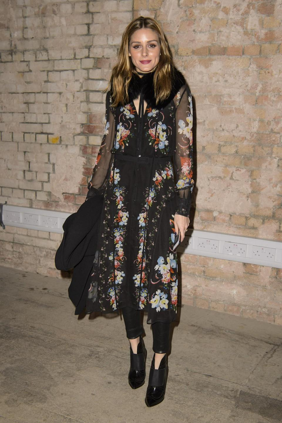 <p>Olivia Palermo opted for a see-through floral shirt. <i>[Photo: PA]</i> </p>