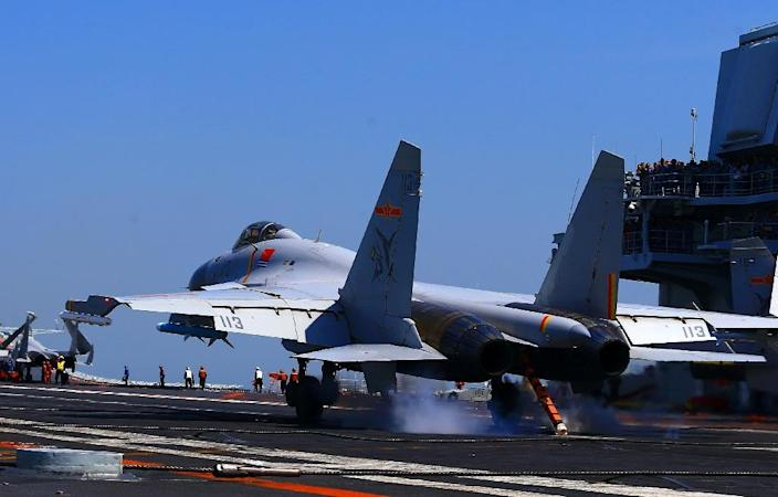 A J15 fighter jet landing on China's sole operational aircraft carrier, the Liaoning, during a drill (AFP Photo/-)