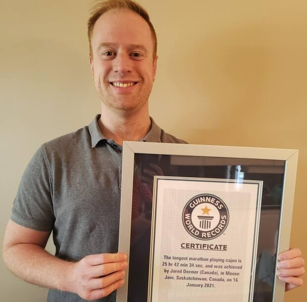 Jared Dormer received his world record certificate in April, after drumming for 25 hours, 42 minutes and 34 seconds earlier this year. (Submitted by Jared Dormer - image credit)