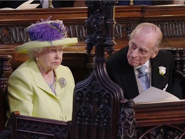 Queen Elizabeth II and Prince Philip, Duke of Edinburgh attend the wedding of Prince Harry to Meghan Markle at St George's Chapel at Windsor Castle on May 19, 2018 in Windsor, England. (Photo by Jonathan Brady - WPA Pool/Getty Images)
