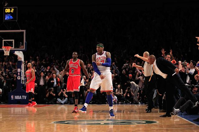 NEW YORK, NY - APRIL 08: Carmelo Anthony #7 of the New York Knicks celebrates his game winning three pointer against as Luol Deng #9 of the Chicago Bulls looks on at Madison Square Garden on April 8, 2012 in New York City. NOTE TO USER: User expressly acknowledges and agrees that, by downloading and/or using this Photograph, user is consenting to the terms and conditions of the Getty Images License Agreement. (Photo by Chris Trotman/Getty Images)