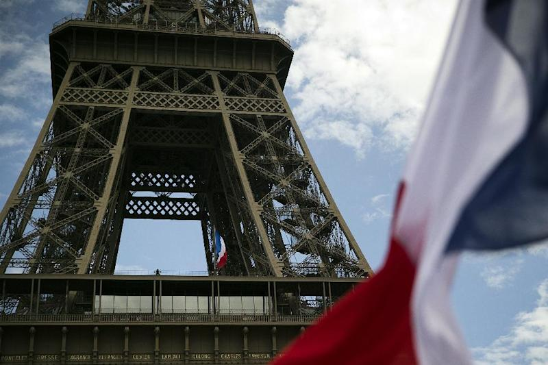 French flags next to the Eiffel tower in Paris, on August 19, 2014