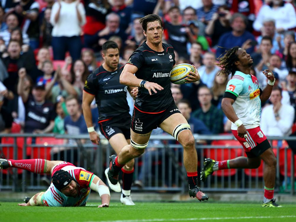 Michael Rhodes crosses the line to score Saracens' third try of the day: Getty