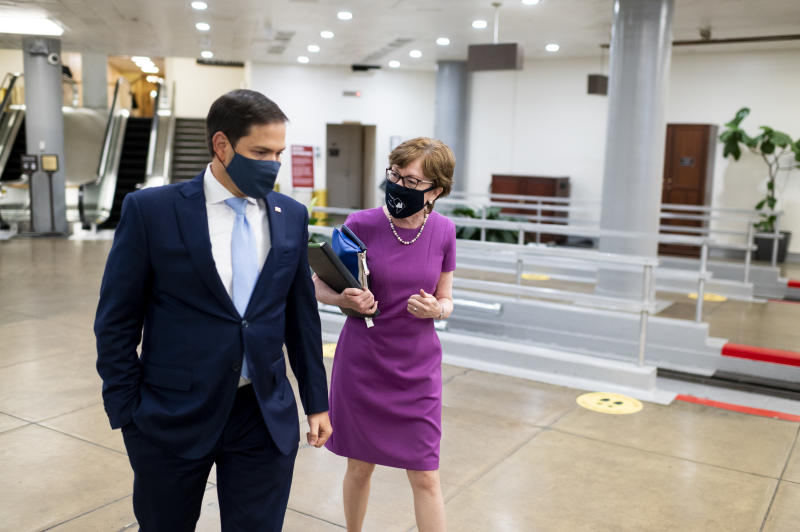 UNITED STATES - JULY 29: Sen. Susan Collins, R-Maine, and Sen. Marco Rubio, R-Fla., talk in the Senate subway on Wednesday, July 29, 2020. (Photo By Bill Clark/CQ-Roll Call, Inc via Getty Images)