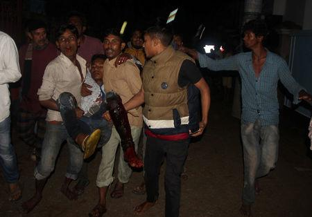 A wounded man is taken to a hospital by local people after a bomb blast in Sylhet