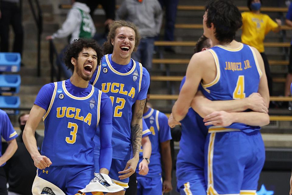 Johnny Juzang #3 of the UCLA Bruins and Mac Etienne #12 celebrate with teammates after defeating the Michigan State Spartans in the First Four game prior to the NCAA Men's Basketball Tournament at Mackey Arena on March 18, 2021 in West Lafayette, Indiana. (Photo by Gregory Shamus/Getty Images)