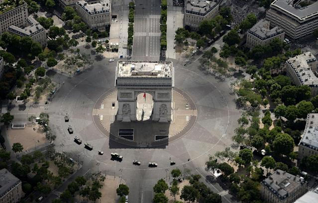 <p>An aerial view shows the Arch of Triumph (Arc de Triomphe) before the annual Bastille Day military parade on the Champs-Elysees avenue in Paris on July 14, 2017. (Photo:Jean-Sebastien Evrard/AFP/Getty Images) </p>
