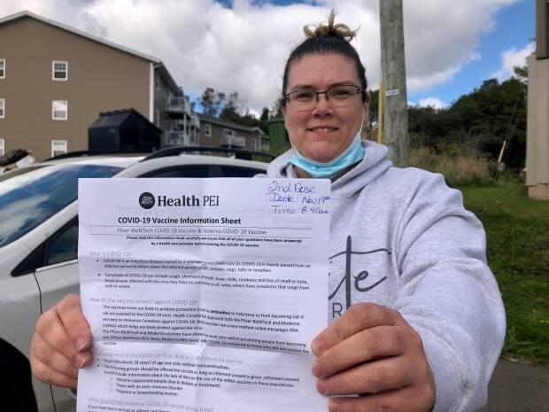 Angela Cameron got her first dose of the COVID-19 vaccine on Monday because she wants to be allowed into rinks and other venues. (Steve Bruce/CBC - image credit)