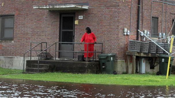 PHOTO: Residents at Trent Court Apartments wait out the weather as rising water gets closer to their doors in New Bern, N.C., Sept. 13, 2018. (Gray Whitley/Sun Journal via AP)