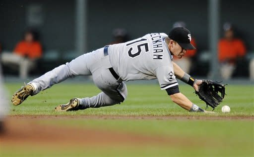 Chicago White Sox second baseman Gordon Beckham (15) tries to field a ball that went for a single by Baltimore Orioles' J.J. Hardy during the first inning of a baseball game, Tuesday, Aug. 28, 2012, in Baltimore. (AP Photo/Nick Wass)